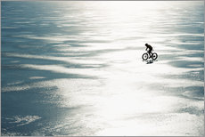 Galleritryck  Man cycling on a frozen lake - Johner