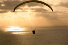 Premiumposter Paraglider over the ocean