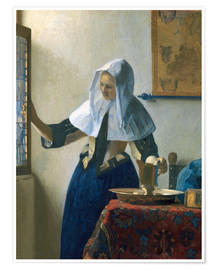 Premiumposter Young woman with a water jug by the window