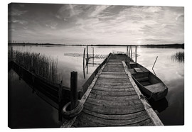 Canvastavla  Wooden pier on lake with fishing boat - black and white - Frank Herrmann