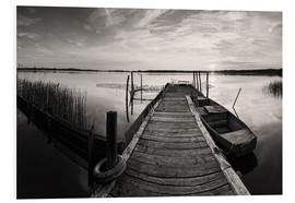 PVC-tavla  Wooden pier on lake with fishing boat - black and white - Frank Herrmann