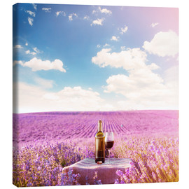 Canvastavla  Red wine bottle and wine glass in lavender field