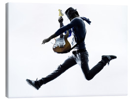 Canvastavla  Guitarist jumping in the air