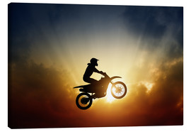 Canvastavla  Biker jumping at sunset