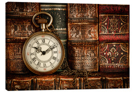 Canvastavla  Clock in front of books
