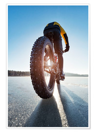 Premiumposter  Man cycling on a frozen lake - Johner