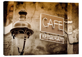 Canvastavla  Cafe sign and lamp post, Paris, France. - age fotostock