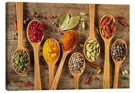 Canvastavla  Colorful spices in wooden spoons - Elena Schweitzer