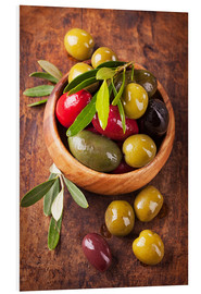 PVC-tavla  Bowl with olives on a wooden table - Elena Schweitzer